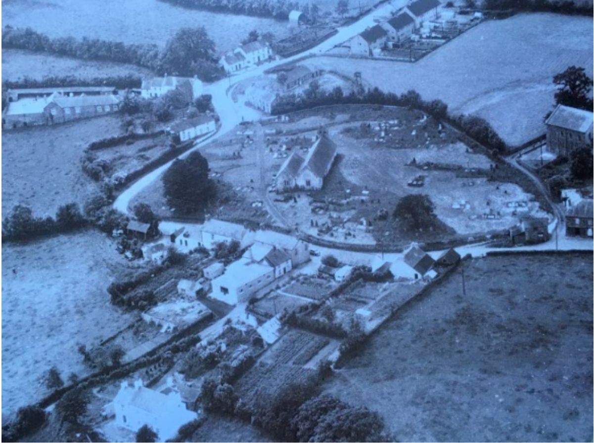 Llansadwrn 1962 aerial shot with view of old garden on the community field